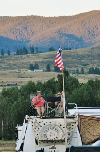 Some fans found the best seats were in the parking lot, high atop their own RV. Photo by Sue Misao