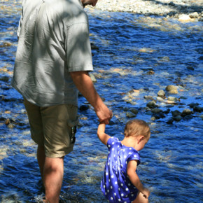 Erick Thompson and daughter Rose test the waters of the Methow River. Photo by Marcy Stamper