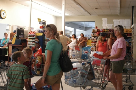 Monday's power outage sent shoppers to the Red Apple Market in Winthrop, resulting in unusually long lines. Photo by Ann McCreary