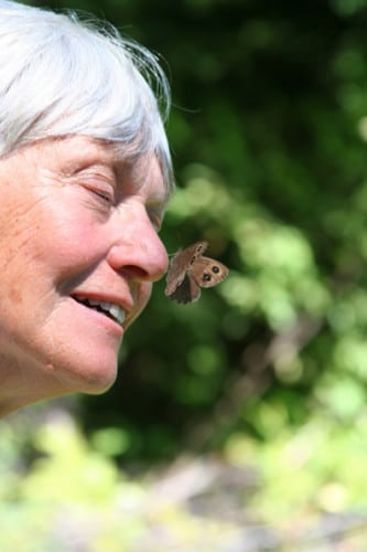 At the August butterflies  workshop with conversationist Robert Michael Pyle at North Cascades Basecamp, Joy Farquarh held a wood nymph on her nose ready for release after learning its life history. Photo submitted by Kim and Steve Bondi