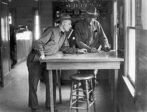 Mr. Pidcock, left, and Mr. Griffiths at the triangulation table in the U.S. Forest Service office in Twisp, around 1940. Photo courtesy of TwispWorks/Shafer Museum.