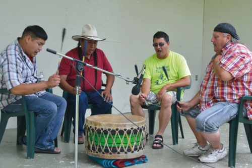 Intertribal drummers and singers John Gunshows of Omak, left, Irvin Sto of Arizona, Jim Roberts of Yakima and Jimmy Case of South Dakota, sang at one of three host drums. Photo by Laurelle Walsh