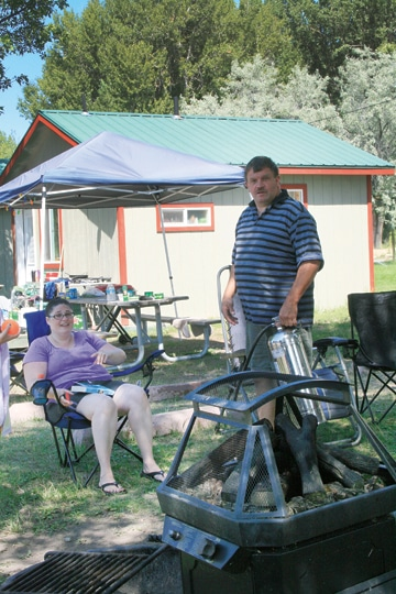 Heather Jameson and Guy Litts of Lynnwood, camping at Pearrygin Lake State Park, were disappointed that the ban on campfires reduced opportunities for socializing. Even the gas grill they brought wasn't permitted. Photo by Marcy Stamper