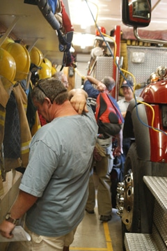 It's a tight squeeze for firefighters suiting up to respond to fires. Photo by Ann McCreary