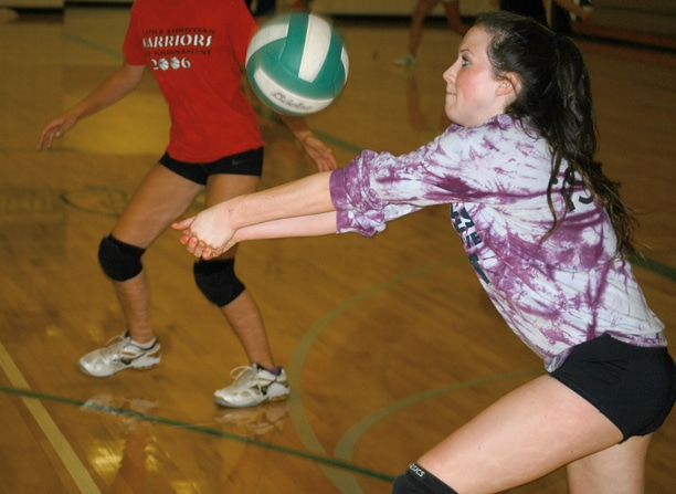Senior Taylor Curtiss, a returning veteran and last season's All League Most Valuable Player, digs under a serve during practice earlier this week. Photo by Mike Maltais