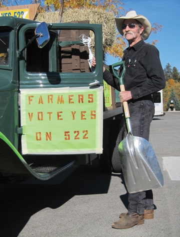 "Twisp farmer Mike Rothgeb is using his 1936 Ford truck to promote a ""yes"" vote on Initiative 522. Photo by Don Nelson"