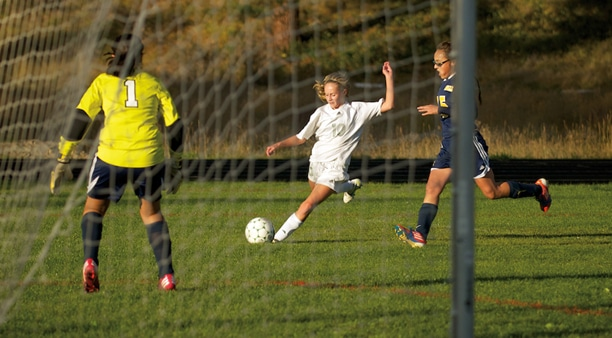 Corinne Dietz winds up for a scoring kick in the Lady Lions' 9-0 win over Oroville. Photo by E.A. Weymuller