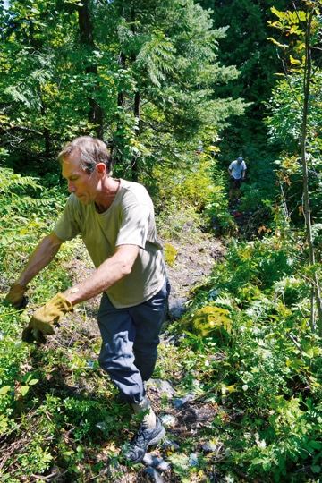 Volunteers Michael Prichard and Doug Curtiss brush out the overgrown Cedar Creek trail in August. Photo by Laurelle Walsh