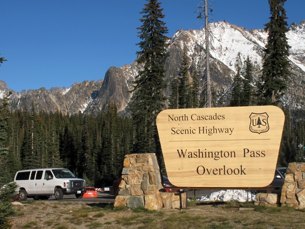 The road to the Washington Pass overlook was gated because of the federal government shutdown, so people parked at the bottom, along the North Cascades Highway, and hiked about half a mile up the road to see the mountains cloaked in an early autumn snow. Photo by Marcy Stamper