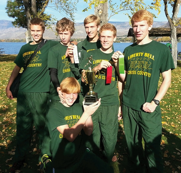 Members of the Liberty Bell High School varsity boys' cross-country team pose with ribbons and the first-place trophy won at the Oroville Invitational last weekend. Standing from left are Josiah Klemmeck, Morgan Ott, Liam Daily, Ben Klemmeck and Willy Duguay. Holding the trophy is Carter Dornfeld. Not pictured is Logan Szafas. Photo courtesy of Jennifer Duguay