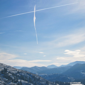 Two high-altitude airplane contrails intersected (although the planes fortunately did not) over Patterson Lake last week to create a cross over the frozen lake. Photo by Don Nelson