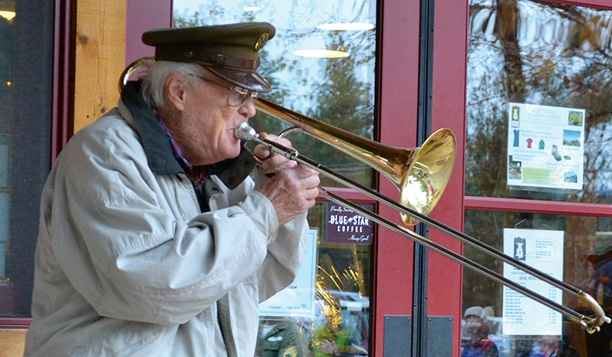 "Royal Canadian Air Force Sergeant Frank Mally served in the Army's 25th evacuation hospital in the Solomon Islands. He played ""Taps"" and ""Amazing Grace"" for those gathered at the Mazama Store. Photo by Laurelle Walsh"