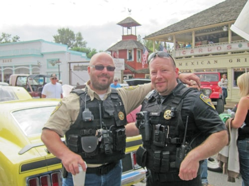 Winthrop deputies Seth Carlson, left, and Ken Bajema at last summer's Vintage Wheels Show. Photo by Don Nelson