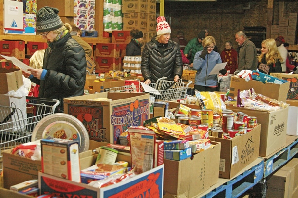 Seven thousand dollars — or more than $1 per Methow Valley resident — was contributed this year by individuals and businesses for food baskets for Neighbors Helping Neighbors and gifts for the Manger Mall.