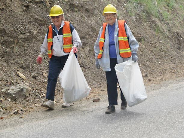 Lois Chavey, left, and Mary Bean helped clean up East Chewuch Road in 2012 as part of the TOPS No. 882 crew. Contributed photo