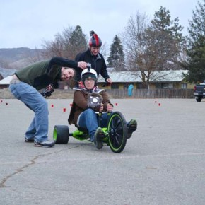 """With some help from """"Mo Fasta"""" and a photographer,  April Wertz prepares to ride. Photo by Laurelle Walsh"""