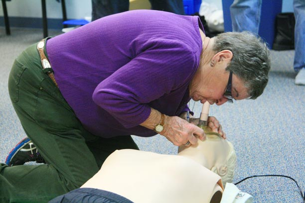 Betty Wagoner practices CPR on a demonstration dummy under the watchful eye of  Kurt Oakley, an advanced emergency technician for Aero Methow Rescue Service, during a training session at the Methow Valley Senior Center.Photo by Marcy Stamper