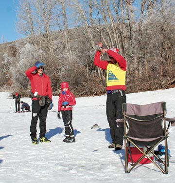 Nils Knudsen, MVSTA ambassador, made the most of his turn checking passes Monday (Jan. 20) by doing a little ice fishing in between chatting with skiers on  Patterson Lake. Photo by Darla Hussey