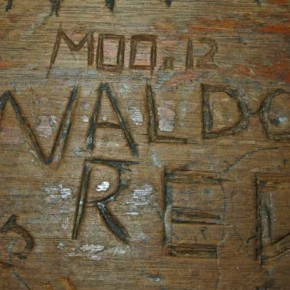 "Over the years, patrons laboriously carved names, designs and messages into the wooden bar top of Antlers Saloon and Cafe, where remembrances of long-gone hunting friends like ""Waldo Red"" remain. Photo by Mike Maltais"