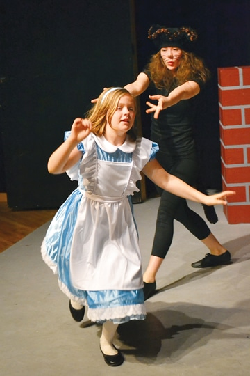 Eliza Kamerling-Brown chased Julia Dietz in The Merc production of Alice in Wonderland. Photo by Laurelle Walsh
