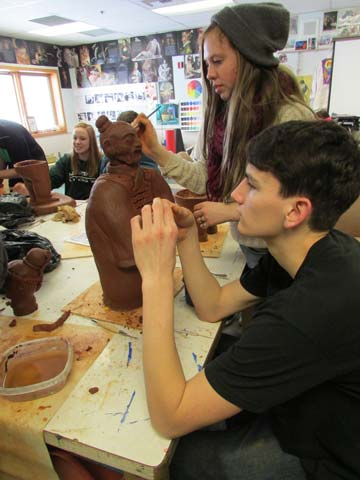 Dana Anderson and Fletcher Rickabaugh put the finishing touches on their terra cotta warrior. Photo by Erin Frey