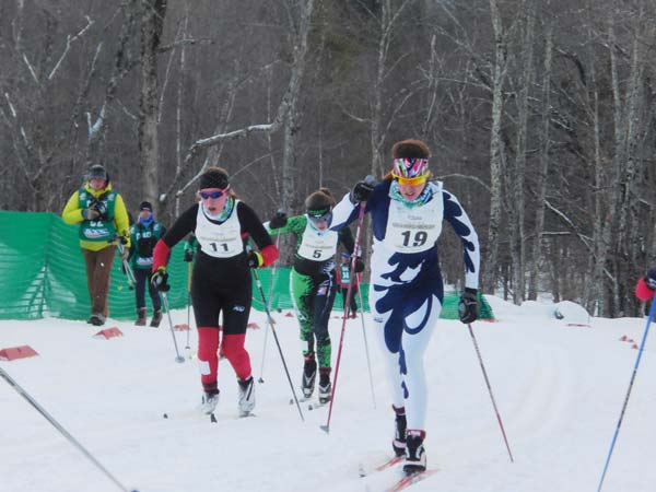 Olivia Ekblad wearing bib No. 19, right, leads the field en route to her first-place finish in the U18 classic sprint quarterfinal race at the Nordic Junior Nationals in Stowe, Vt., last week. Ekblad advanced to the finals where she placed ninth. Photo courtesy of Leslie Hall