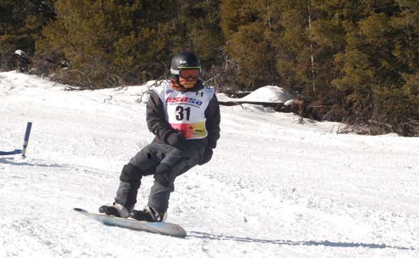 Loup Snowboard Team member Zyan Shull negotiates a gate on the slalom course during the fourth annual Loup Snowboard Races last weekend at the Loup Loup Ski Bowl. Shull finished first in all four of the events in his age group.  Photo by Mike Maltais