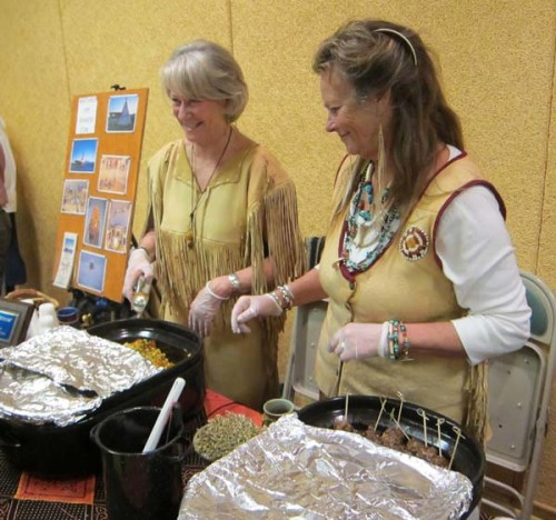 Mary Pat Eauman, left, and Suekii Cornwall  of Winthrop Tipi Dinners help another diner decide what to add to their plate. Photo by Don Nelson