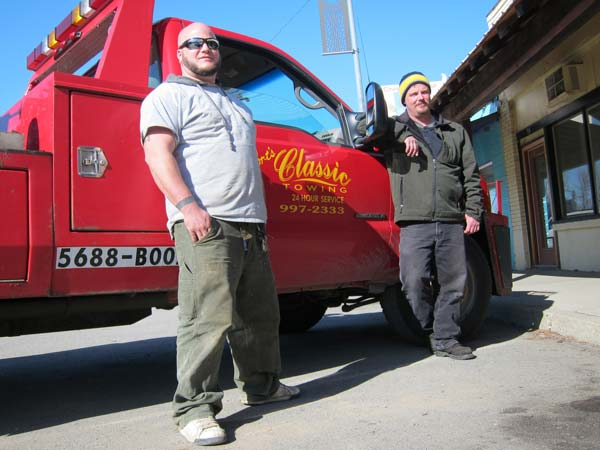 Tyler Welborn, left, and his brother Jeremy are the new owners of Classic Towing in Twisp. Photo by Don Nelson
