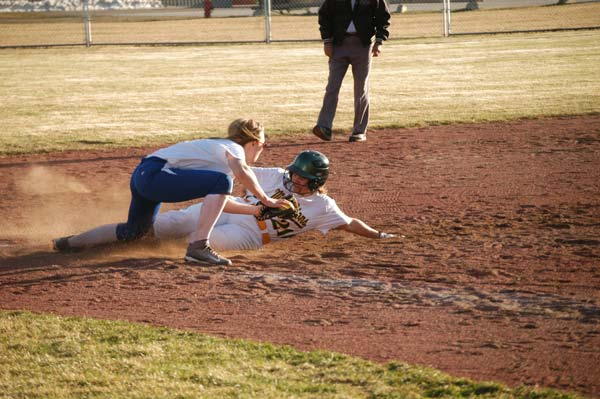 Senior Julie McMillan beats the throw to third base during non-league action against Tonasket last week. At the plate, McMillan went 2-5 to help the Lady Lions win the game, 19-6. Photo by Mike Maltais