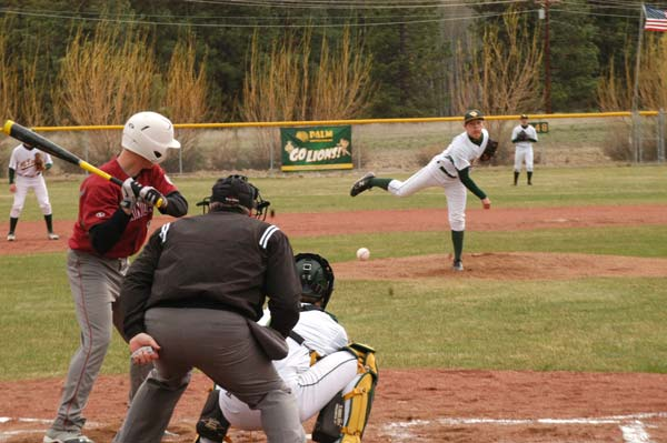 Derek Alumbaugh delivered a smoker to an Okanogan batter last Thursday as the Mountain Lions battled to a 2-1 non-league win over the Bulldogs. Photo by Mike Maltais