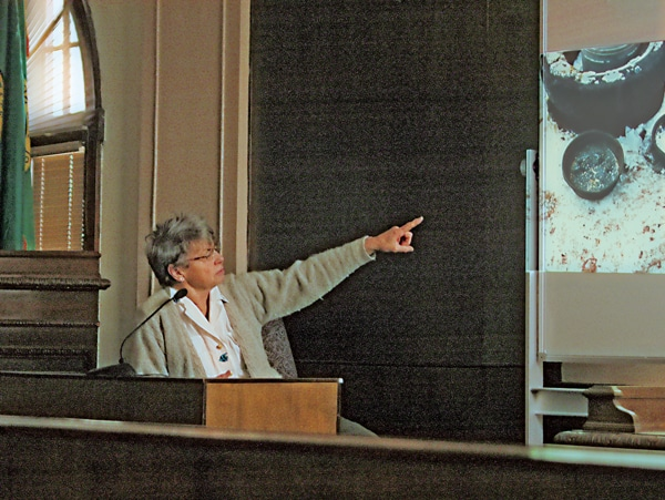 Judy Brezina Camp pointed to a photo used in her trial last week. Photo by Ann McCreary