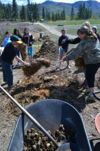 Jed McMillan and Hailey Dammann lay straw onto a compost pile they helped build at Classroom in Bloom last week. Assisting in the effort are Cheyenne Fonda, left, Stephanie Miranda, Christy Yieth, Maya Schrager and Chloe Blum. Photo by Laurelle Walsh