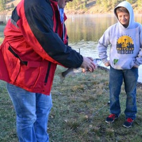 Thirteen-year-old William Thompson of Seattle admires one of Rick Thordarson's fine catches on opening day at Pearrygin Lake. Photo by Laurelle Walsh