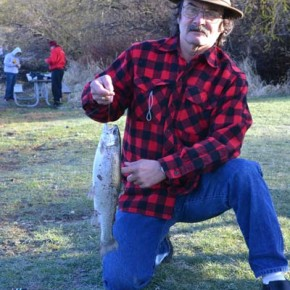 """Bruce Cournoyer of Tacoma hauled in """"probably a two-pounder"""" from the shore on opening day. Photo by Laurelle Walsh"""