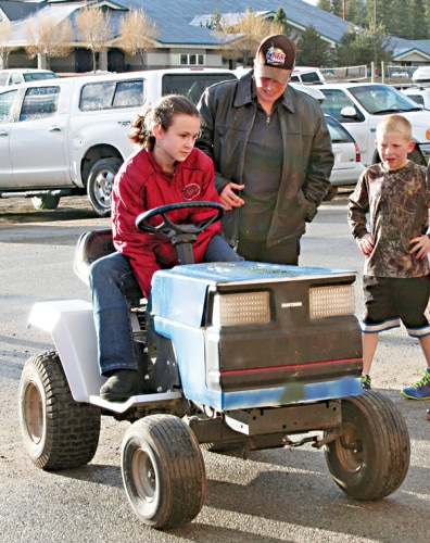 "Kristy Viteh, an MVES sixth-grader, built an electric-powered go-kart. She worked with her mom to gut an old mower and, according to Kristy, ""hook up an electric motor using a bunch of wires and it just worked."" Photo by Darla Hussey"