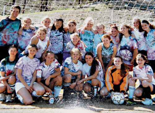 "A group of girls, including many of the founding team members, decked out in practice ""uniforms"" they made themselves."