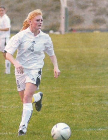Senior striker Katie McCurry looks for an opening during a 2004 regular season game. McCurry was voted an All-Conference player during the varsity girls' first year as an all-girl team in 2002 and led the Lady Lions in scoring with 21 goals. MV News archive photo