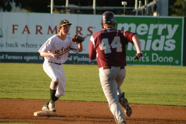 Shortstop Chip Jones awaits the throw that will force out the Kittitas runner at second base. The Coyote didn't slide into the bag, interfering with Jones's throw to first base and a possible double play. Officials cited interference and ruled the runner out at first.Photo by Mike Maltais