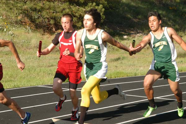 Cesar Dominguez passes the baton to Jaymis Hanson in the first exchange of the 4x100-meter relay at the Liberty Bell Invite last Friday. The Mountain Lions crossed the finish line first. Photo by Mike Maltais
