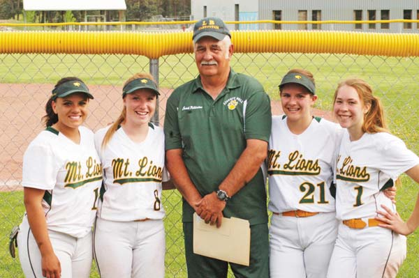 Senior softball players Korrie Perryman, left, Katherine Tannehill, Julie McMillan and Lily Darwood join coach Lee Pilkinton, who honored the four girls during their last home appearance against Manson on Thursday (May 15). Photo by Mike Maltais