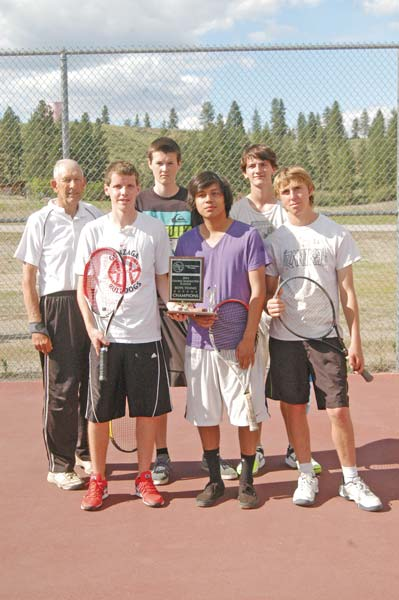 Members of the state-bound Liberty Bell High School varsity tennis team join coach Dave Schulz, left, with the first-place trophy the boys won last week at district competition in Ephrata. Pictured are Daniel Sonnichsen, second from left, Josh Frey, Carlos Perez, Fletcher Rickabaugh and Corey Diamond. Photo by Mike Maltais