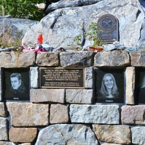 """The Thirtymile Fire memorial, which reads """"They will not be forgotten,"""" sits at the Chewuch River site where four young firefighters—Tom Craven, Jessica Johnson, Devin Weaver and Karen Fitzpatrick—lost their lives  in 2001. The memorial has attracted the offerings of countless individuals over the years, but especially last summer when wildland firefighters from across the country came again to the valley to fight the Carlton Complex Fire. Recent visitors to the site have left written messages, signed T-shirts, caps, bottles of Gatorade and tins of chewing tobacco on the rock wall above engraved portraits of the fallen.Photo by Laurelle Walsh"""