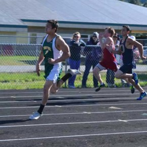 Jose Dominguez leads the pack in the 100-meter dash. Photo by Laurelle Walsh