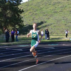 Liam Daily rounds the bend in the 1600-meter run. Photo by Laurelle Walsh