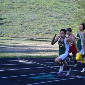 Jaymis Hanson hands off to Jose Dominguez in the 4x100-meter relay. Photo by Laurelle Walsh