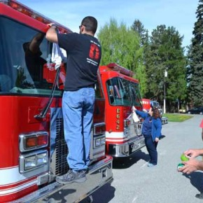 Fire District 6 volunteers shine up the fire engines at the station before the parade. Photo by Laurelle Walsh