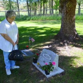Ruth Miller Mihelich, born and raised in the Methow Valley, pauses at the grave of a Watson relative.Photo by Laurelle Walsh