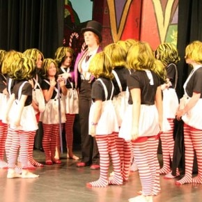 The Oompa Loompas look to Wonka (Morgan Tate) for direction. Photo by Darla Hussey
