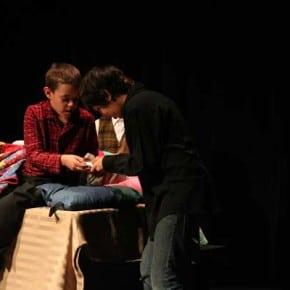 Charlie's grandpa (Nicholas White) helps Charlie (Myles Davis) unwrap his second attempt at finding a golden ticket. Photo by Darla Hussey